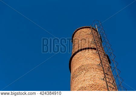 Brick Tower Of Old Abandoned Factory. Ancient Architecture. Abandoned Grain Receiving Cooperative Fa