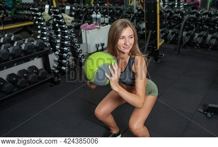 Functional Training. Bodybuilding And Fitness. Young Cheerful Woman Practicing Squats With Medicine