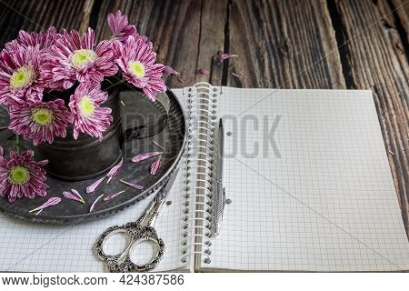 Notebook, Pen, Chrysanthemums In A Vase And Decorative Scissors. Businesswoman Set. Case Planning Co