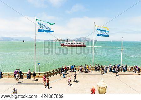 San Francisco, California, Usa - July 24, 2018: Tourists Enjoying View Of Alcatraz Island From Pier
