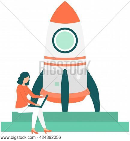 Woman Working On Business Startup. Launch Of Rocket Standing On Pedestal. Person With Laptop Works W
