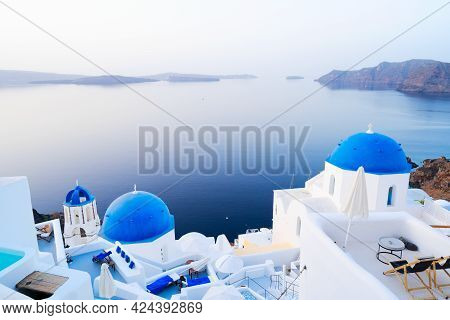 White Church Belfry, Blue Domes And Volcano Caldera With Sea Landscape, Beautiful Details Of Santori