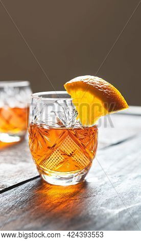 Traditional Belgian Tangerine Liqueur In A Glass On An Old Wooden Table