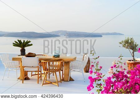 Cafe Table With Caldera View, Beautiful Details Of Santorini Island With Flowers