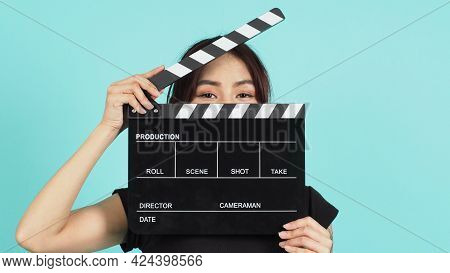 Woman Holding Black Clapperboard Or Movie Slate Use In Video Production ,film, Cinema Industry On Gr