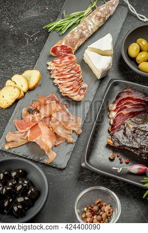 Set Of Various Kind Of Smoked Sliced Cured Meat. Duck Breast, Jerky Ham And Traditional Dried Sausag