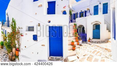 Greece, Cyclades. Beautiful Lefkes traditional greek village in Paros island. typical whitewashed houses and floral narrow streets.
