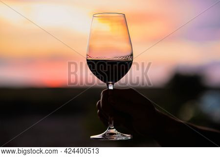 Sunset With A Glass Of Wine.beautiful Sky With Sunset With A Glass Of Wine.a Glass Of Wine At Sunset