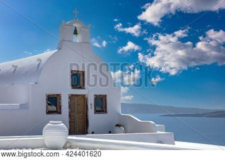 Santorini Island, Greece. White Orthodox Church Oia Village, Cyclades,