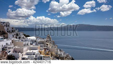 Santorini Island, Greece. Fira Caldera Over Aegean Sea, Blue Sky, Calm Sea