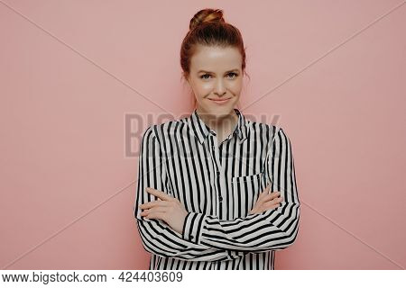 Satisfied Happy Redhead Teen Girl With Hair In Bun Looking Straight And Smiling Joyfully At Camera W