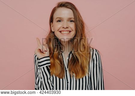 Young Smart Woman With Long Hair In White Striped Shirt, Generated New Idea, Showing It With Gesture