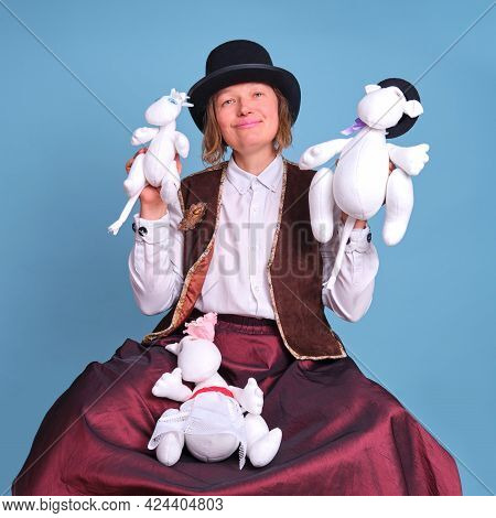 Actors With Moomin Troll Dolls On A Blue Background - Moscow, Russia, April 28, 2021