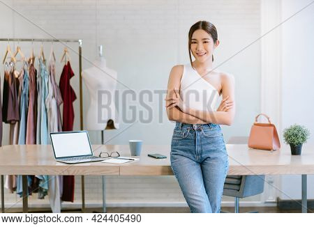 Portrait Of Beautiful Young Asian Woman Fashion Designer Working Small Business Owner Standing With