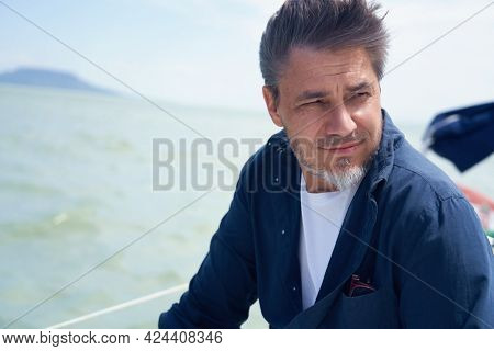 Portrait of mature age, middle age, mid adult man in 50s, happy confident smile. Outdoor, sailor, boat,