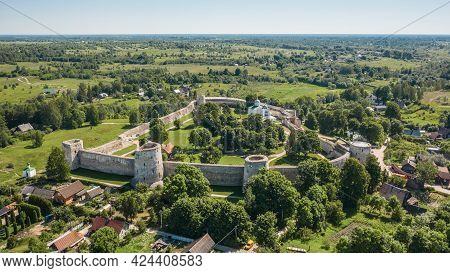 Aerial View Of Izborsk Fortress In Russia. Semi-ruined Walls, Towers And Courtyards Around A 14th-ce
