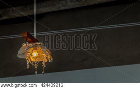 Decorating Hanging Ceiling Design Lighting Bulb. Orange Warm Tone Light Color Bulb Light With Dark T