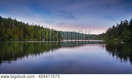 Panoramic view of Pass lake landscape in twilight with perfect reflections
