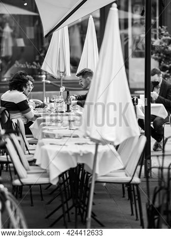Strasbourg, France - May 19, 2021: Side View Of Young People Eating Outside At Maison Kammerzell Ico