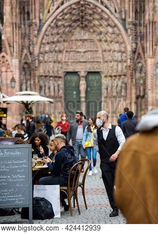 Strasbourg, France - May 19, 2021: Waiter With Mask Near Terrace As Bars And Restaurants Reopen Afte