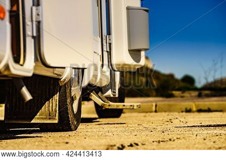 Camper, Recreational Vehicle Outdoor And Trash Can On Door Entrance. Camping On Nature. Holidays And