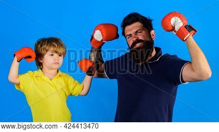 Little Boy Sportsman At Boxing Training With Coach. Child Boy Doing Boxings Exercise With Father. Da