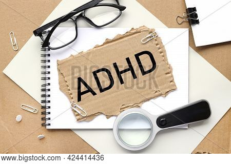 Adhd Is Attention Deficit Hyperactivity Disorder. Text On Cardboard In Black Letters