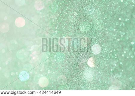 Glittery bokeh pattern on a green background