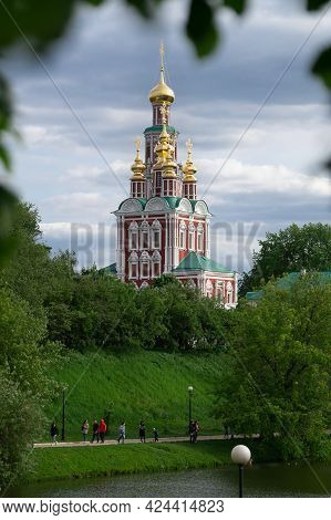 Moscow, Russia-may 30, 2021.view Of The Moscow Novodevichy Monastery With Blurred Tree Leaves On The