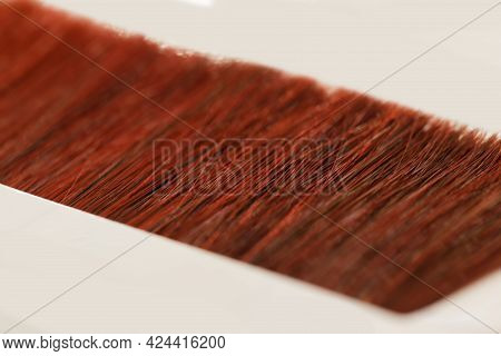 Hair Samples In Small Strands Stacked In A Line On A White Table