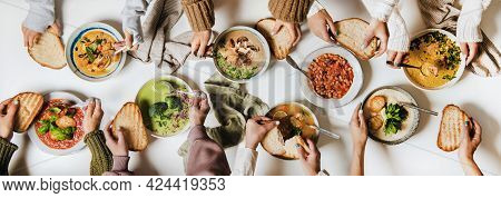 People Eating Various Autumn And Winter Creamy Vegan Soups Together