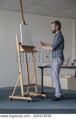 Art Academy Deventer, The Netherlands, June 17, 2021: Art Teacher Provides Demonstration On How To P