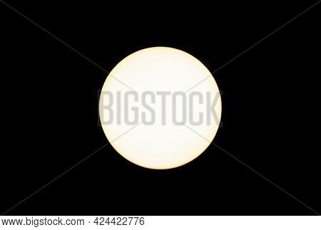 Led Soft Warm Light Bulb Lit Isolated On Black Background From Overhead View. Yellow Color To The Li