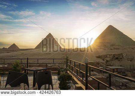 Great Pyramids Of Chephren Khafra And Cheops Khufu And Mikerina Menkaura. Cairo, Egypt. Sunset On Gi
