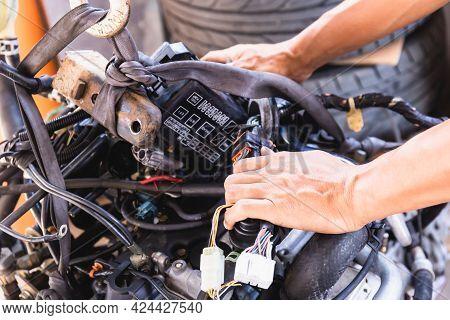 Hands Of Auto Mechanic Working On Car Engine In Mechanics Garage, Repair And Maintenance Service