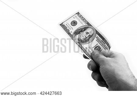 A Hundred-dollar Bill In His Hand On A White Background. Isolated. Black And White Style. One Hundre