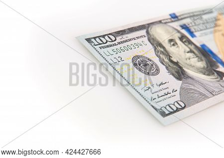 A Hundred-dollar Bill On A White Background. The One Hundred North American Dollars Bill Is Not Full