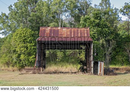 An Old Rusting Shed That Was Once Part Of A Sugar Mill Infrastructure Now Falling Apart In Disrepair