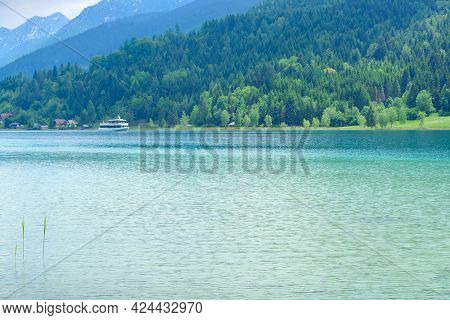 Lake Weissensee In Carinthia And A Boat In The Distance