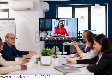 Manager Woman Sitting In Front Of Camera Talking On Video Call During Virtual Conference Working Bus