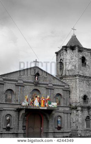 a colored belen with a black and white background of the pagbilao church in Quezon province Philippines. poster