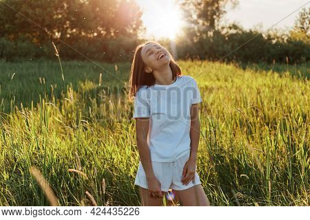 Portrait Of Laughing Dark Haired Girl Wearing Casual Style Closing , Female With Toothy Smile Enjoyi