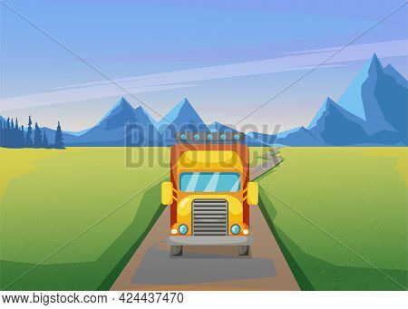 Front View Of Big Truck Driving Down Road Through Field. Vehicle On Path, Mountain Range In Backgrou