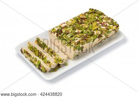 Plate with traditional Turkish pistachio halva and slices close up