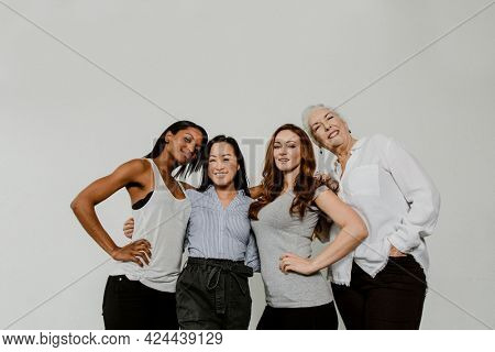 Cheerful diverse women in a white room