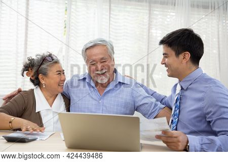 Happy Senior Couple During The Meeting With Agent Or Financial Advisor Consultant, Southeast Asian E