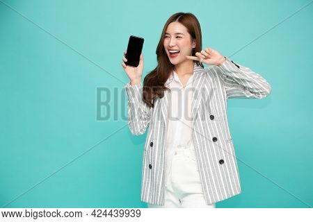 Portrait Of Southeast Asian Business Woman Showing Or Presenting Mobile Phone Application On Hand Is