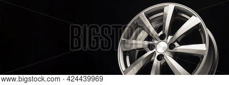 Grey Alloy Wheel, Modern Auto Parts. Black Background Copy Space