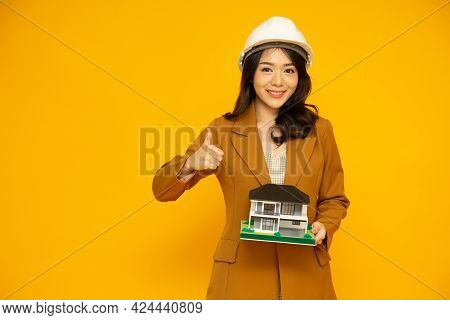 Home Inspector Asian Woman Or Engineer Showing Thumbs Up Wearing White Helmet And Holding Single-fam
