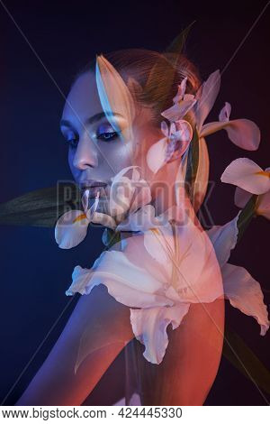 Beauty Flowers Face Of A Woman With Double Exposure. Portrait Of A Girl Neon Light And Color, Profes